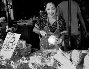 Pineapple woman Thai market photo by Tord Remme